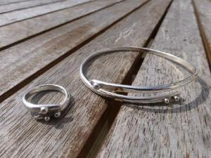 Wrap-around round bangle with 3 silver nuggets