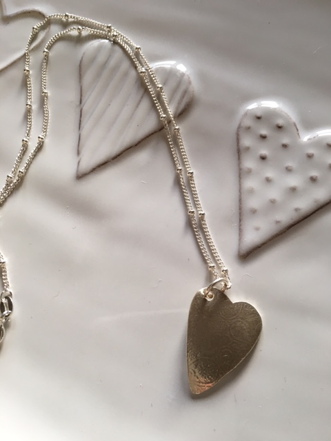 Delicate silver heart on ball chain