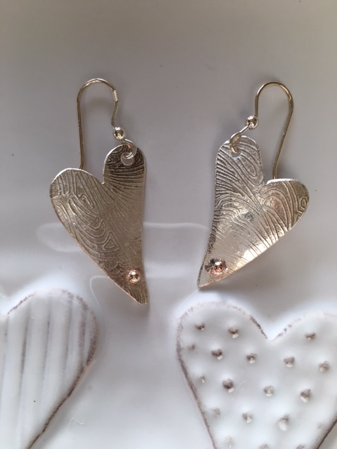 Textured heart dangles with gold nuggets