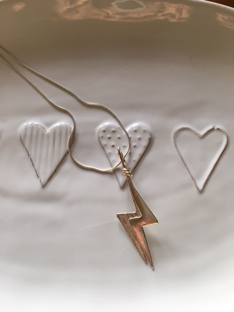 Lightning bolt pendant on long chain