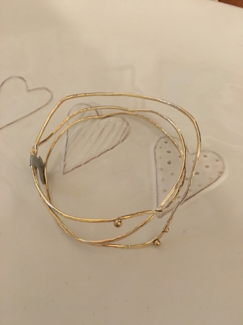 3 strand silver bangle with gold nuggets